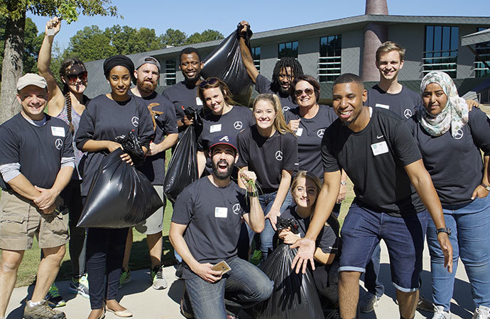 Mercedes-Benz employees enthusiastically help clean up the Fayetteville campus.