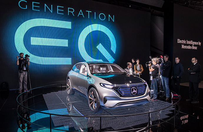 A Mercedes-Benz EQ SUV is unveiled at an auto show