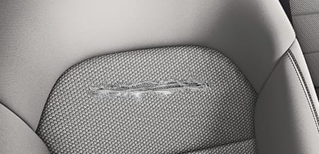 A close-up of a tear in the upholstery of a seat