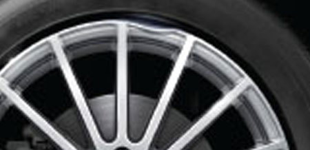 A close-up of a dented rim.