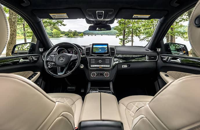 An interior shot of the wide-open cabin of a Mercedes-Benz SUV.