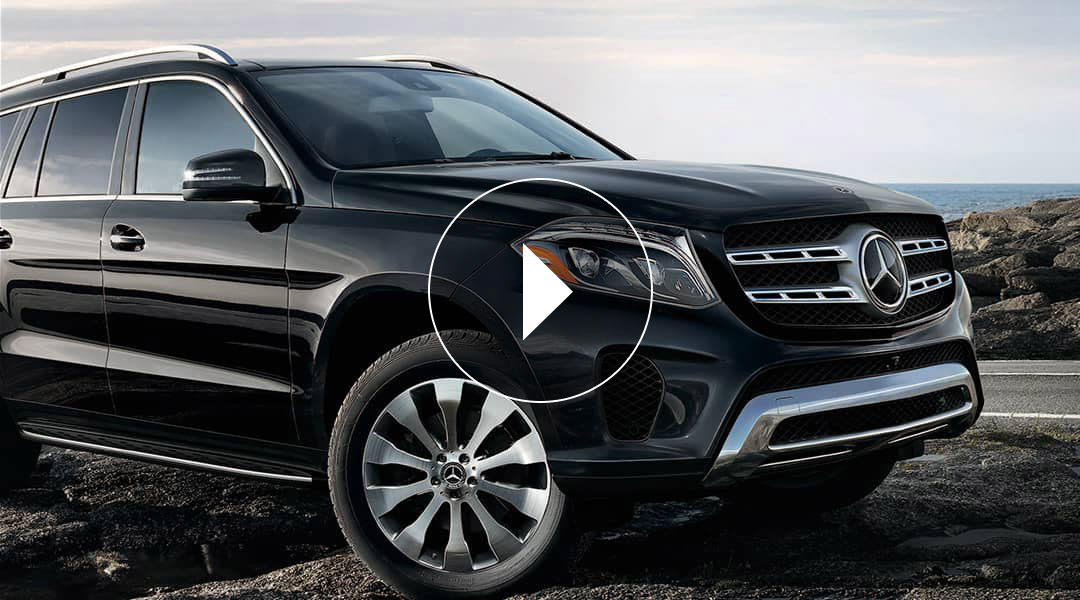 A black Mercedes-Benz GLA SUV conquers a rough patch of terrain.