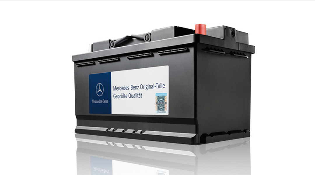 Genuine Mercedes-Benz Battery on a white background