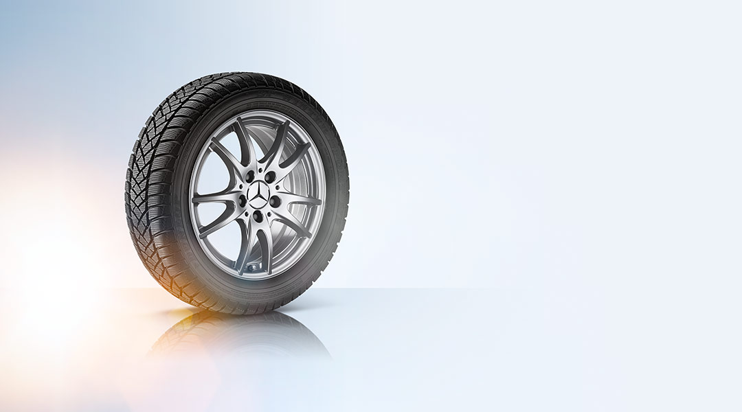 A wheel and tire on a white background.