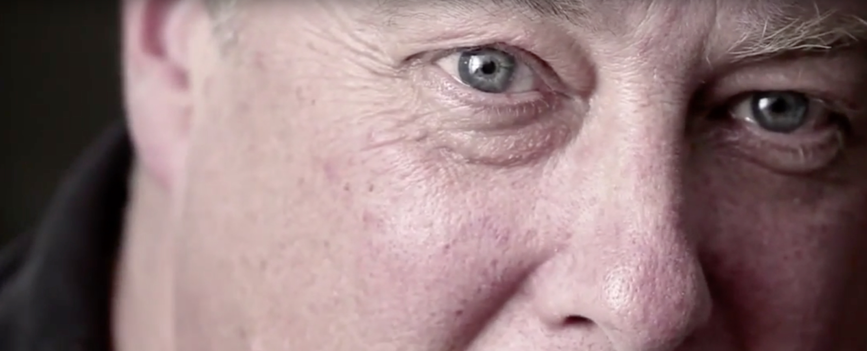 A close-up of a man's eyes as he tells an emotional story.
