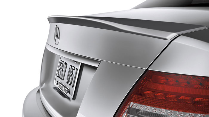 A rear spoiler accentuates the muscular C-Class.