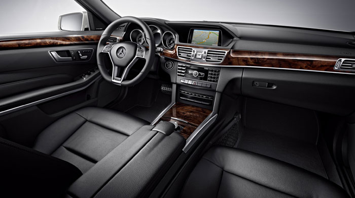 4MATIC® Sport Sedan in Black with Burl Walnut wood trim