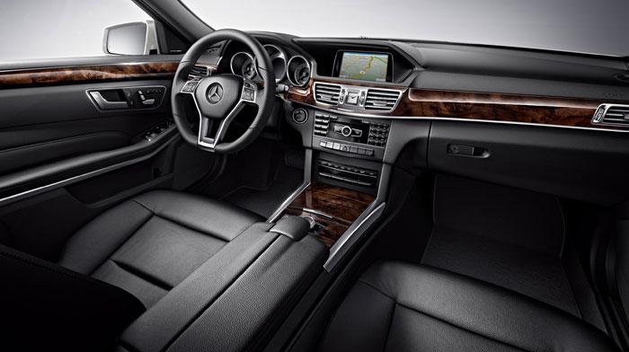 4MATIC® Sport Sedan in Black with Burl Walnut wood trim