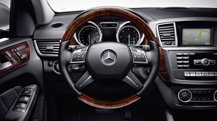 in Black with wood/leather steering wheel and Premium Package